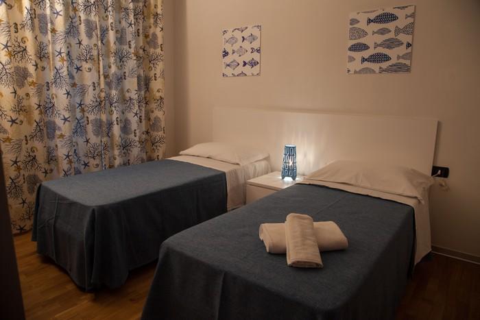 camera-letto-appartamento-per-le-vacanze-notte