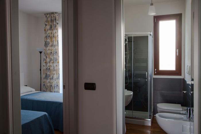 camera-letto-appartamento-per-le-vacanze