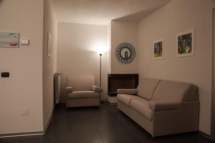 posti-letto-divano-soggiorno-casa-vacanza